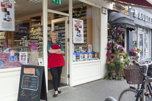 Image of Nourish female staff member standing in doorway of shop