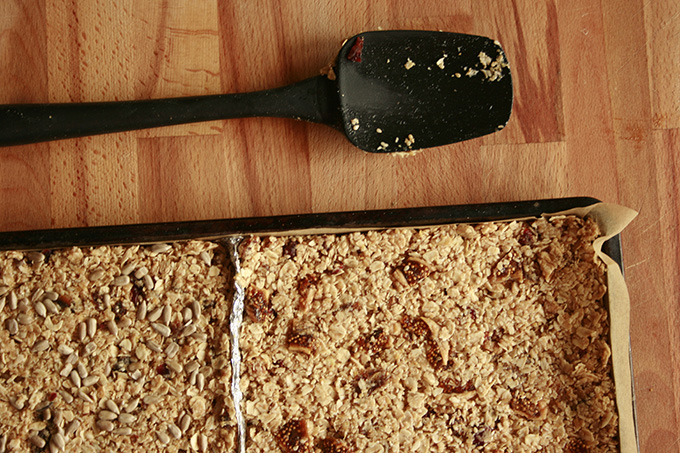 fruit and seed oat squares in a tray with spoon
