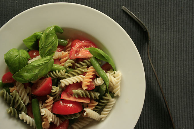 Rice pasta with tomato green beans and basil