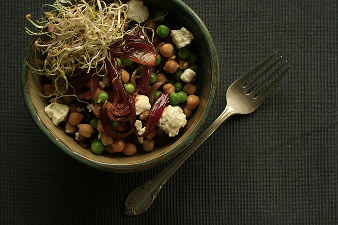 chickpea and feta salad with sprouts in a bowl