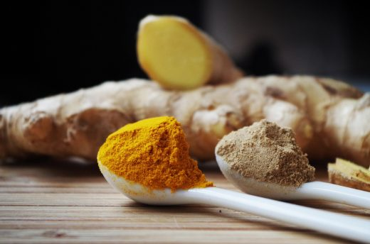 Image of ginger with spoons of spices